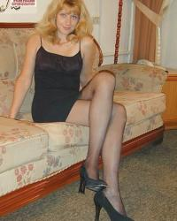 Woman in little dress, black pantyhose and black court shoes