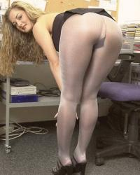 Secretary in little dress, grey opaque pantyhose and black light sandals