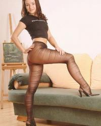 Sexy woman in black striped pantyhose
