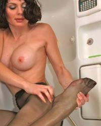 Sexy woman naked in black pantyhose