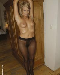 Sexy woman naked in black pantyhose tied up