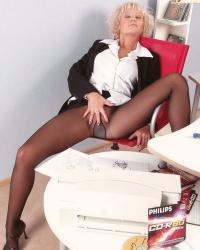 Secretary in little suit, black pantyhose and black court shoes with bridge strap