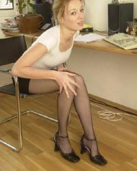 Secretary in black pantyhose